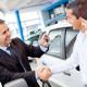 636072639959966989-1736428352_Happy-Car-Salesman-closing-deal